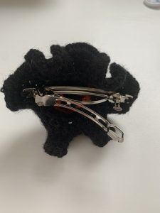 hair clip sewn onto witch hat crochet